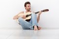 Young man playing guitar Royalty Free Stock Photo