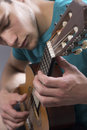 Young man playing guitar close up of Royalty Free Stock Photography