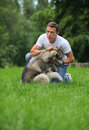 Young man playing with his Alaskan Malamute Royalty Free Stock Photo