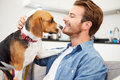 Young Man Playing With Pet Dog At Home Royalty Free Stock Photo