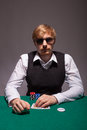 A young man is playing poker Stock Photography