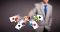 Young man playing with poker cards and chips Royalty Free Stock Photo