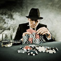 Young man playing poker selected focus on eyes Stock Photo