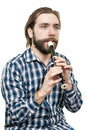 The young man playing on a recorder it is isolated white background Stock Photography