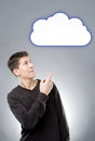 Young man pointig on illustrated cloud Royalty Free Stock Photography