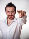 Young man pointing a finger towards you attractive Royalty Free Stock Images