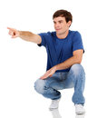 Young man pointing handsome over white background Royalty Free Stock Photos