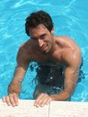 Young man in pool Stock Photography