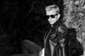 Young man posing in leather jacket cool fashionable black and wh Royalty Free Stock Photo