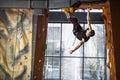 Young man practicing rock climbing in climbing gym indoor Stock Photos
