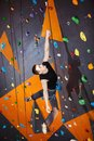 Young man practicing rock climbing in climbing gym indoors Royalty Free Stock Photo