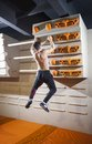Young man practicing rock climbing in climbing gym indoors Stock Photography