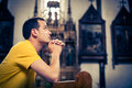 Young man praying in a church Royalty Free Stock Photo