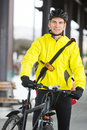 Young man in protective gear with bicycle portrait of smiling Stock Image