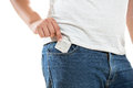 Young man putting condom in jeans pocket Royalty Free Stock Photo