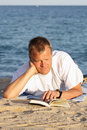 Young man reading Royalty Free Stock Photo