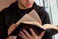 Young man reading bible Stock Photos