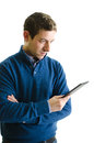 Young man reading ebook reader isolated handsome holding and an Stock Image