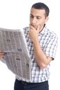 Young man reading newspaper Stock Image