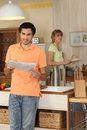 Young man reading a newspaper Royalty Free Stock Photo