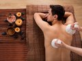 Young man receiving massage with stamps in spa high angle view of men Stock Photo
