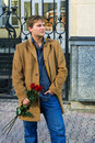 Young man with a red roses Royalty Free Stock Photo