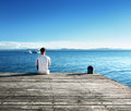 Young man relax siting on pier Stock Photo