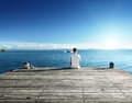 Young man relax siting on pier Stock Photography