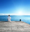 Young man relax siting on pier Stock Photos