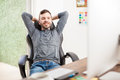Young man relaxing at the office Royalty Free Stock Photo