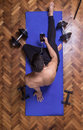 Young man relaxing smartphone elevated view exercise mat Royalty Free Stock Photo