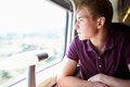 Young Man Relaxing On Train Journey Royalty Free Stock Photo