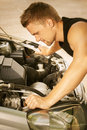Young man repairing car Stock Photo