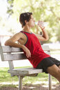 Young Man Resting After Exercise In Park Royalty Free Stock Photo