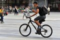 Young man rides on a bicycle fit cyclist in profile cologne germany Stock Photos