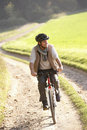 Young man rides his bike in park Stock Photography