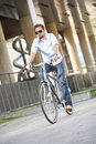 Young man riding bicycle Royalty Free Stock Photos