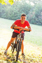 Young man riding bicycle smiling Royalty Free Stock Photography