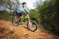 A young man riding a mountain bike Stock Photography
