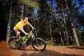 Young man riding a mountain bike downhill style Royalty Free Stock Photography