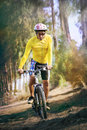 Young man riding mountain bike mtb in jungle track use for sport healthy and holiday activities life style Stock Photos