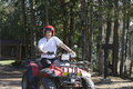 Young man riding a quad in quebec rural road canada Royalty Free Stock Image