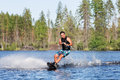 Young man riding wakeboard on summer lake Royalty Free Stock Photo