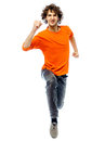 Young man running front view one caucasian in studio white background Stock Photo