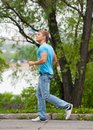 Young man running through park Stock Photos