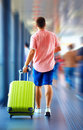Young man runs hurry in order not to miss the plane a Stock Photos