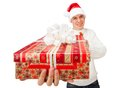Young man in santa claus hat holding a gift box portrait of handsome big red Royalty Free Stock Image