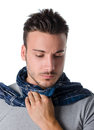 Young man with scarf holding his neck because of throat ache suffering expression Royalty Free Stock Photos