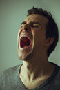 Young man screaming concept Stock Image
