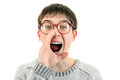 Young man screaming in glasses is a loud isolated on the white background Royalty Free Stock Photos